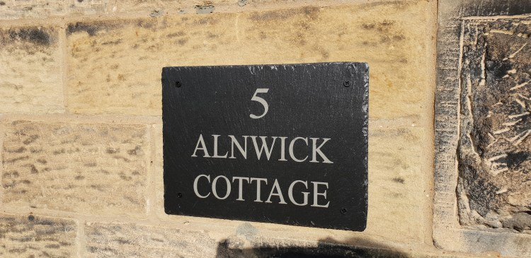 The name plaque at Alnwick Cottage