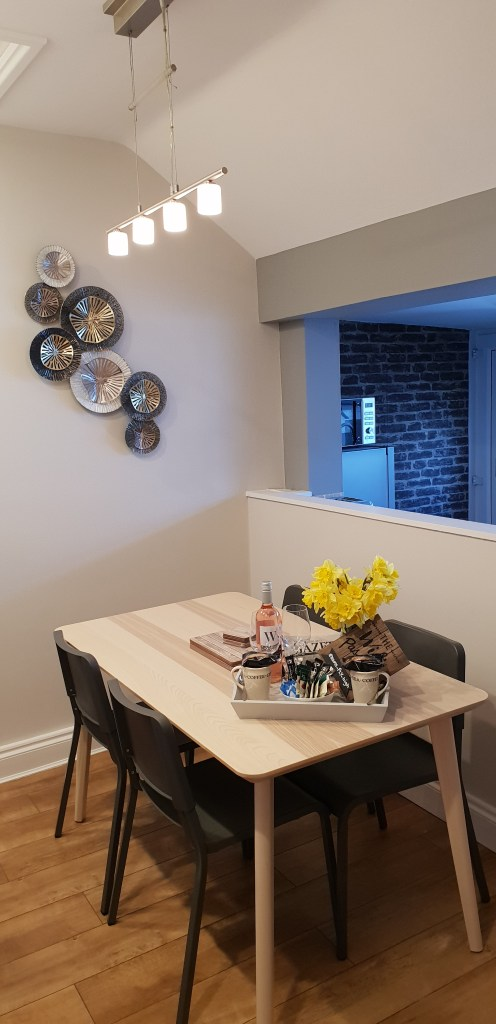 View across the dining area towards the kitchen