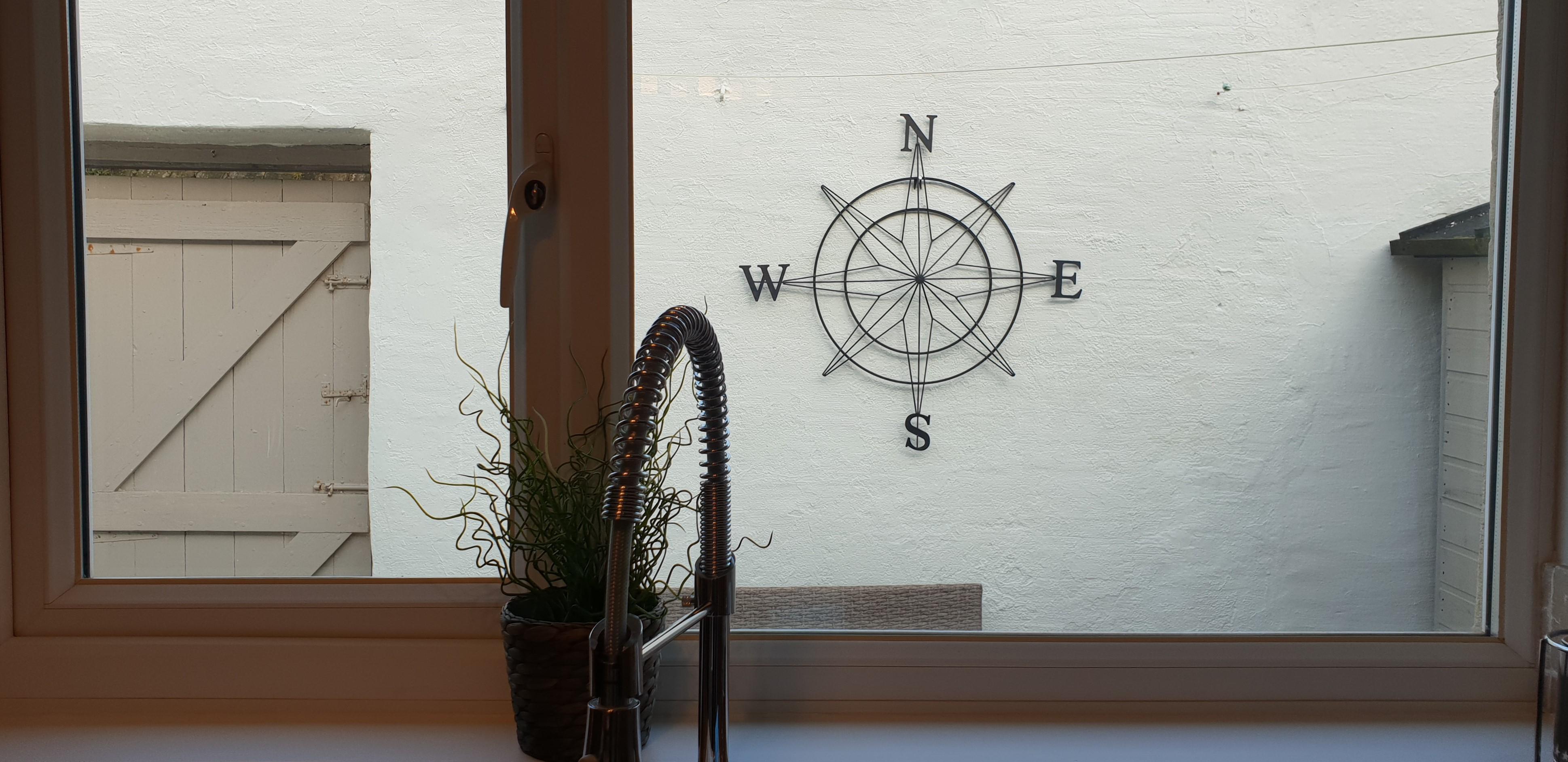 Outdoor compass wall art