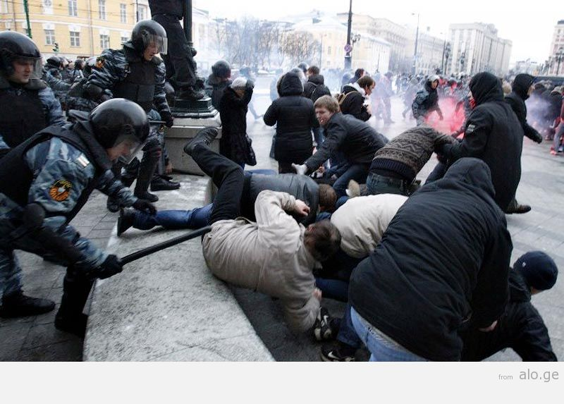 Police scuffle with protesters during a rally in central Moscow
