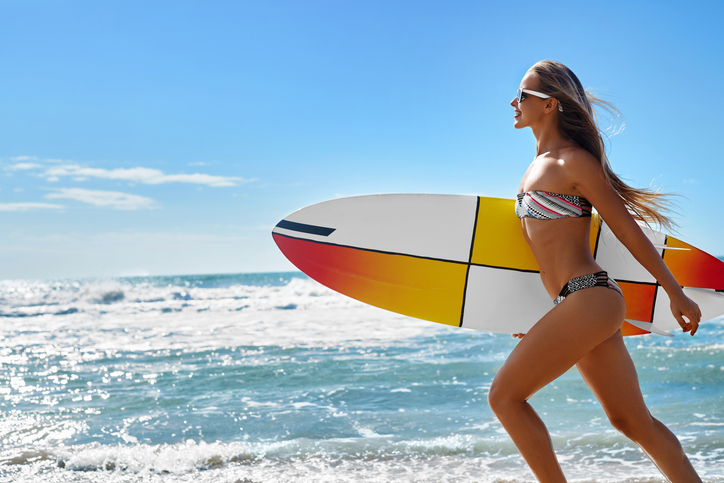Extreme Water Sport. Surfing. Girl With Surfboard Beach Running.