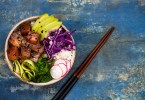 Hawaiian tuna poke bowl with seaweed, avocado, red cabbage slaw