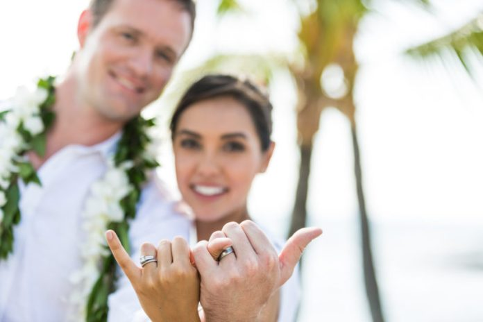 Newlyweds throwing a shaka after their wedding. Photo Credit: Hawaii Tourism Authority (HTA) / Tor Johnson