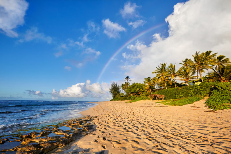 A rainbow pops up over Sunset beach. The Best Beaches In Oahu's North Shore For Families.