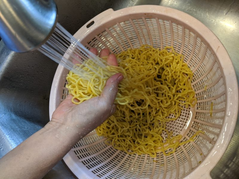 Rinse with cold water to remove the starch.