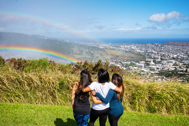 Looking out at a rainbow and downtown Honolulu from Tantalus.