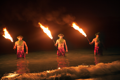 Watching three men and their fireknife performance in Maui.