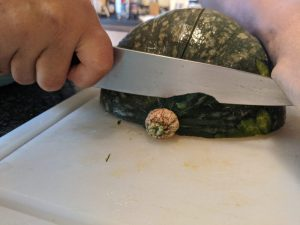 Cut the kabocha in half and cut off the stem.