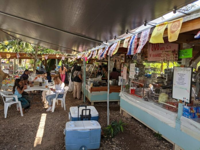 Under the large tent you'll find the main booths selling the more authentic dishes popular with the local Thai community.