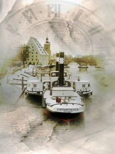 Ruthof mit Freudenau (Museumsschiffe) und im Hintergrund, der Salzstadel und Brückturm mit Ziffernblatt