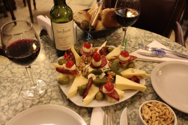 Buenos Aires Food Guide: Cafe Tortoni cheese plate and Malbec, via A Lo Profile