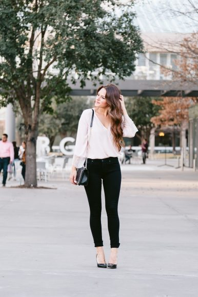 A Little Bit of Lace: Blush, lace top paired with black skinny jeans, pumps, and statement earrings. Click through to the post on A Lo Profile to shop!