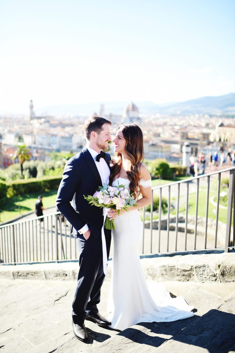 I shared that we decided against a first look, so after our wedding ceremony, we took some quick family photos and then drove off to Piazzale Michelangelo to take our wedding photos as a couple. Piazzale Michelangelo is a lookout point up on top of a hill in Florence with a gorgeous panoramic view of the city. You can see the Duomo, the Ponte Vecchio, and more all from this location. As you'll see in our photos together, it is beautiful. It is also VERY crowded almost any time of day, so we were definitely fighting off crowds of people to get the shots!
