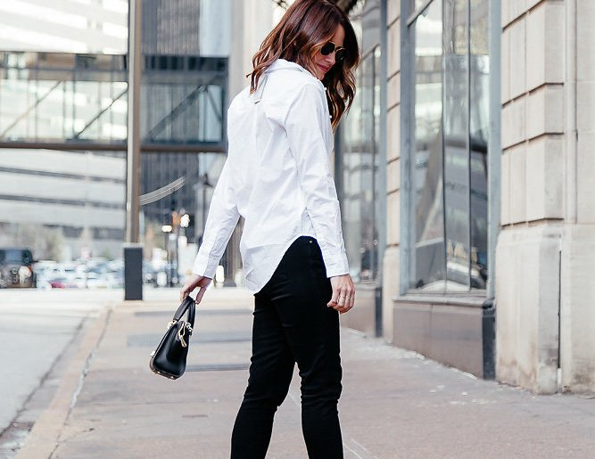 Dallas blogger sharing a twist on the classics in an effortless outfit including an embellished white button down paired with raw hem black skinny jeans. #whitebuttondown #blackskinnyjeans #classicstyle #embellished
