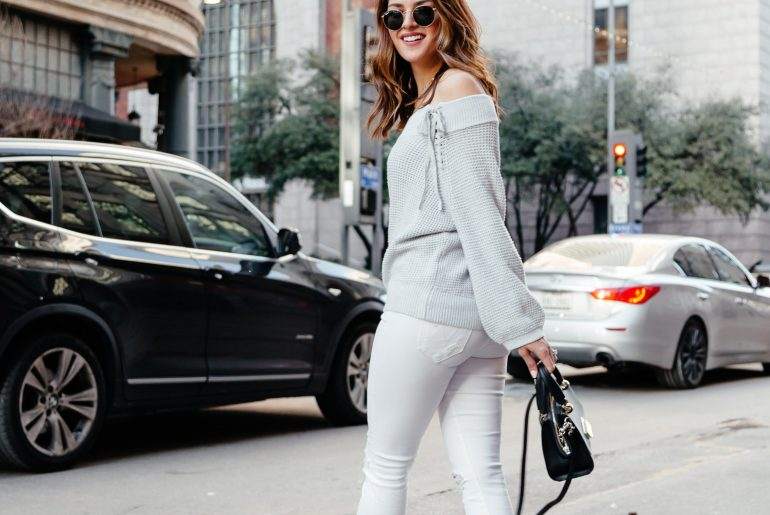 White Jeans for spring: Dallas blogger sharing how to style white jeans in a transitional spring look featuring an off the shoulder sweater. Plus, a round up of the cutest white jeans to shop now. #whitejeans #springlook #springstyle #offtheshouldersweater