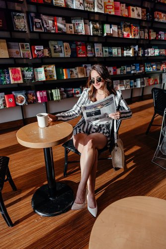 Dallas blogger A Lo Profile in a striped two piece short suit drinking coffee