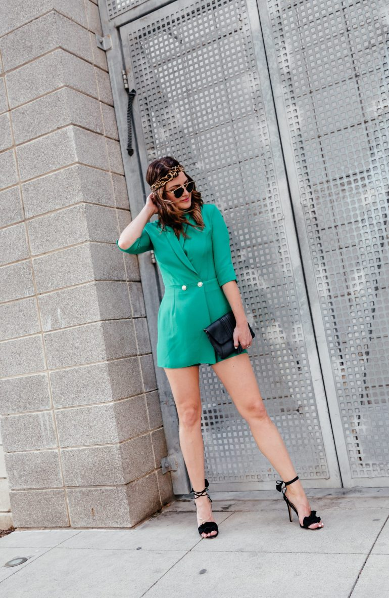 7a39fb56d3d5 A Lo Profile wearing an emerald green blazer romper by River Island with a  leopard headband