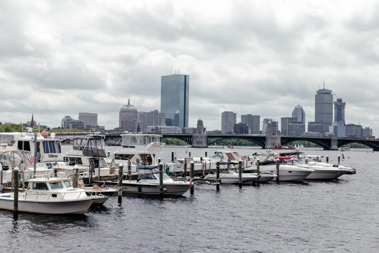 Boston city view with the Charles River and boats via A Lo Profile's Boston Travel Guide