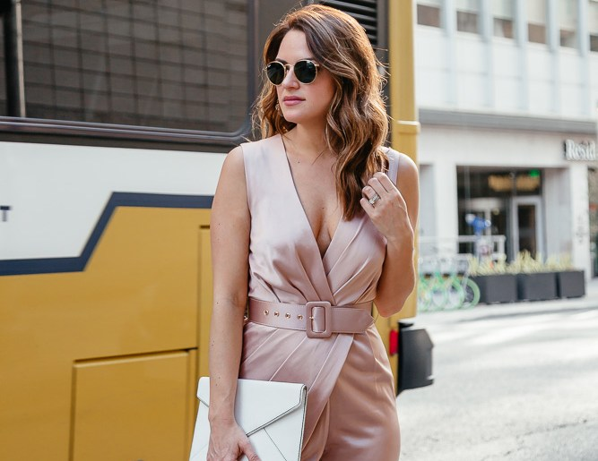 Dallas lifestyle blogger A Lo Profile wearing a blush Misha Collection jumpsuit thats perfect for a dressed up any cocktail occasion.