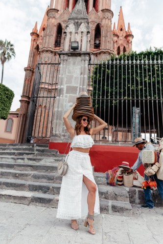 Dallas blogger A Lo Profile wearing a white two piece lace set crop top and maxi skirt by Tularosa with a gray Chloe pixie bag, gray Jeffrey Campbell tassel heels, and glitter Gucci aviator sunnies in San Miguel de Allende.
