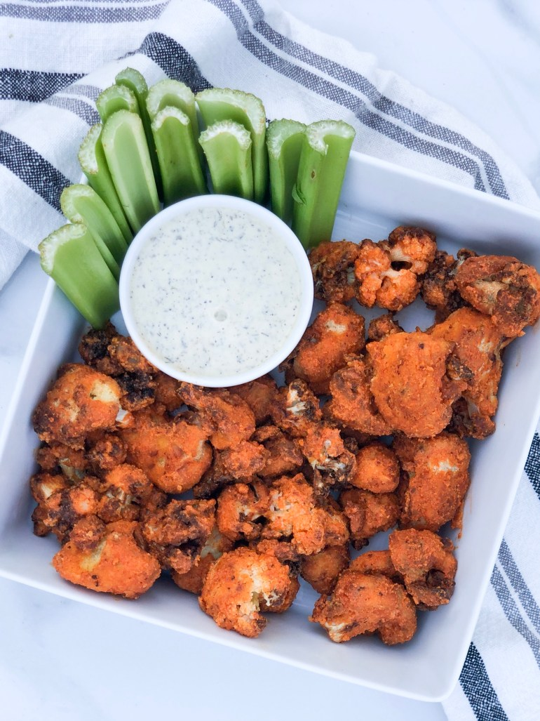 Sharing a quick & easy, Whole 30 approved buffalo cauliflower recipe made with almond flour & Frank's red hot sauce in the air fryer.