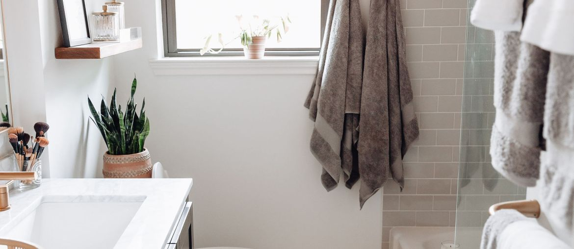 Sharing our hall bathroom reveal featuring before & after bathroom remodel pictures & links to everything we got for our new bathroom.