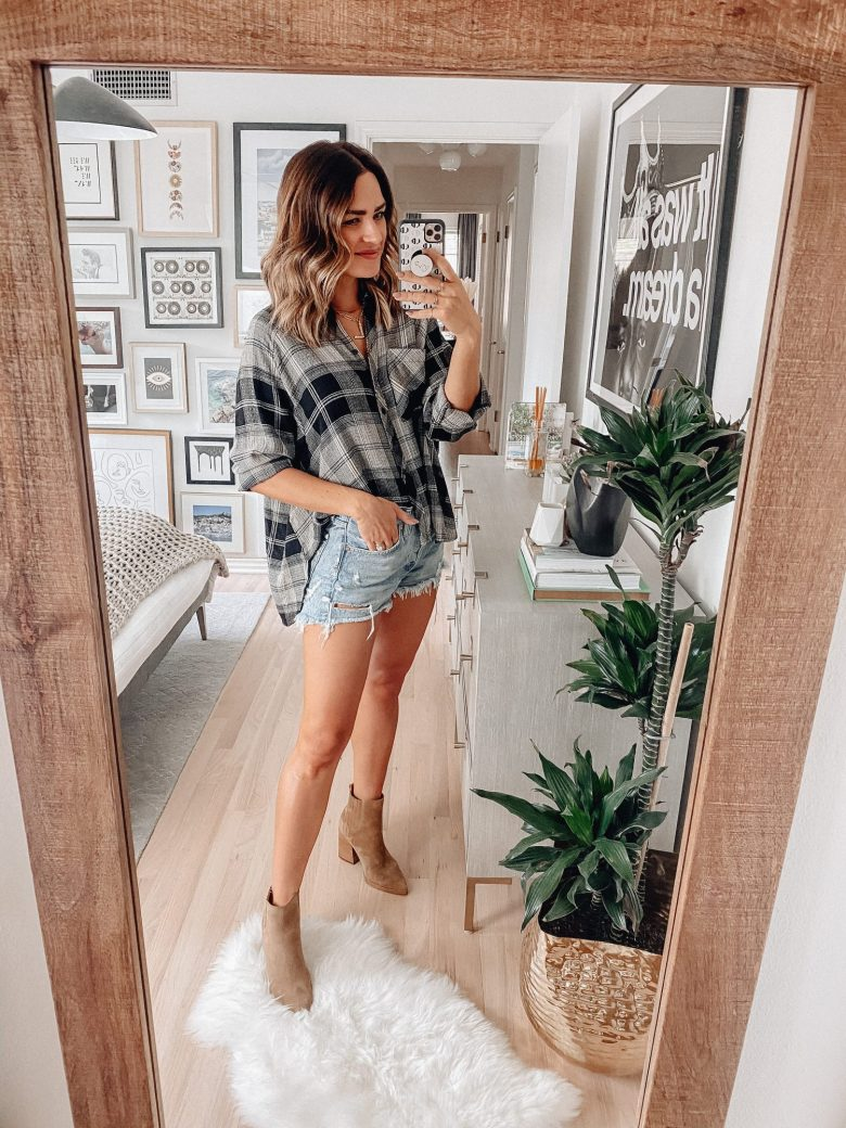 Sharing 13 ways to style a flannel for fall featuring an under $60 flannel style plaid shirt & outfit ideas ranging from super casual to date night.