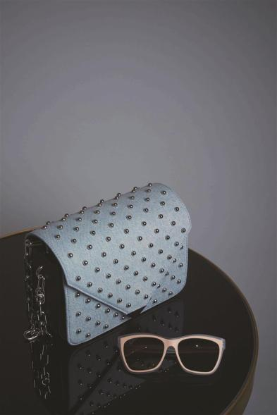 Bag: Alexander Wang - Al Ostoura Thuraya Mall, Al Ostoura The Avenues Sunglasses: Balenciaga - Thuraya Mall