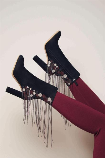 Boots: Chloé Trousers: Alaia