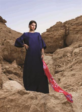 DRESS: Reem Acra - Al Ostoura Thuraya Mall SCARF: Leonard - Al Ostoura Thuraya Mall EARRINGS & BRACELET: Lanvin - Thuraya Mall