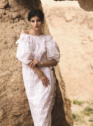 DRESS: Simone Rocha - Al Ostoura Mezzanine Thuraya Mall, Al Ostoura The Avenues BRACELET & EARRINGS: Vintage Chanel - What Goes Around Comes Around Thuraya Mall