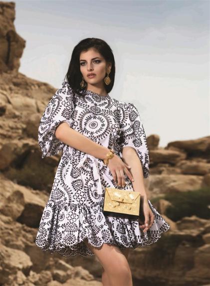 DRESS: Alexander McQueen - Thuraya Mall, Al Ostoura Salhiya Complex BAG: Okhtein - Al Ostoura Mezzanine Thuraya Mall, Al Ostoura The Avenues EARRINGS & BRACELET: Vintage Chanel - What Goes Around Comes Around Thuraya Mall