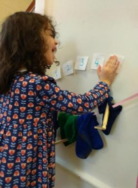 """Here, Coco is feeling happy and at ease, recreating her own washing line, interpreting in her own way the narrative in Jez Alborough's book """"The Washing Line"""""""