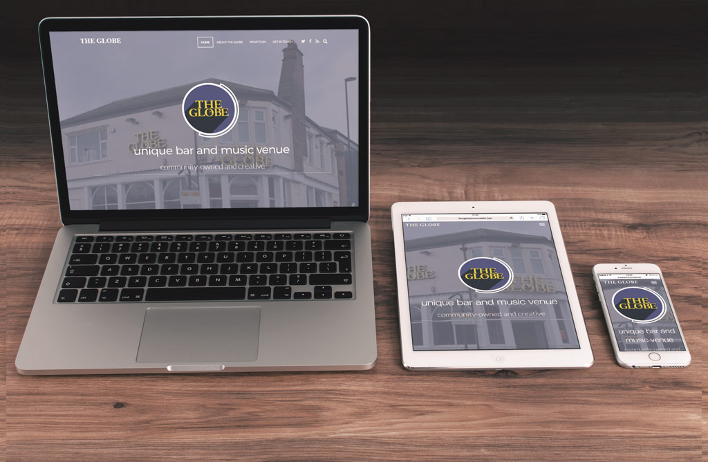 The globe website on a laptop, ipad and iphone