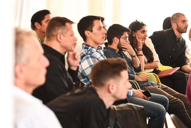 Seminar Transcription Service; a group of people sitting and listening to the speaker
