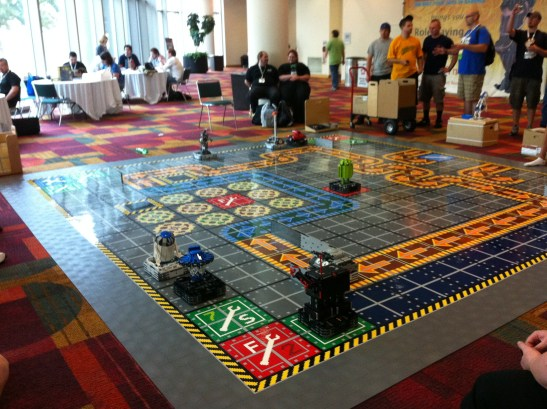 Someone made a huge Robo-Rally game mat withby LEGO Minstorm robots. You actually could play,programing the robots per the board game rules!