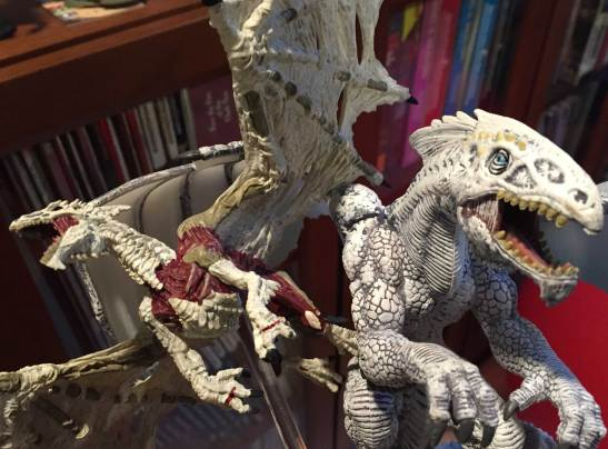 White Dracolich on left, old gargantuan White Dragon on right.