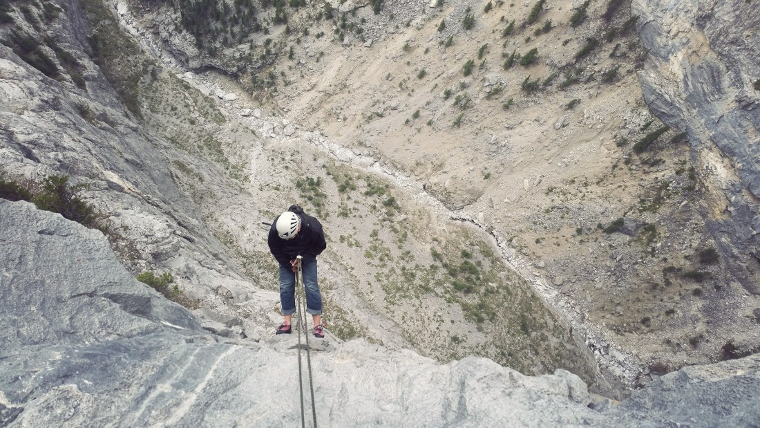 Doug rappelling the top pitch of Tall Storey in Echo Canyon