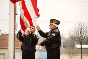 Members of the VFW raise the flag at Alpine Shop O'Fallon's Grand Opening celebration on Friday, March 22.