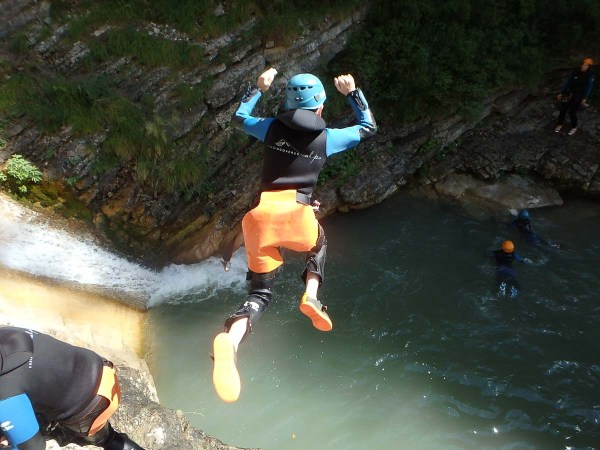 Canyoning jump in the Alps