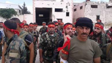 صورة حشود عسكرية لـ لواء القدس بمدينة الميادين في طريقها الى البادية