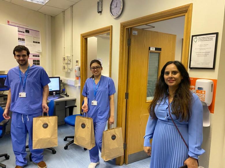 Tiba Raja with NHS staff