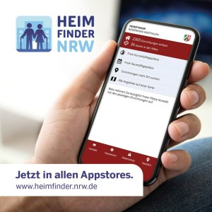 Bild einer Hand, die ein Handy festhält, auf dem die Heimfinder-NRW-App geöffnet ist.