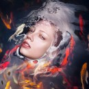 Striking Portraits of Women Submerged Beneath a Barrier of Water