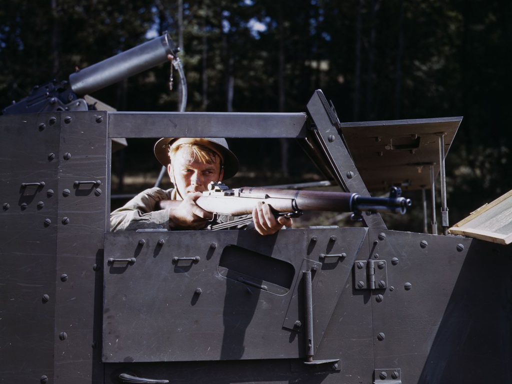 Life at Fort Knox in 1942 - 8. An infantryman takes aim with his M1 Garand rifle