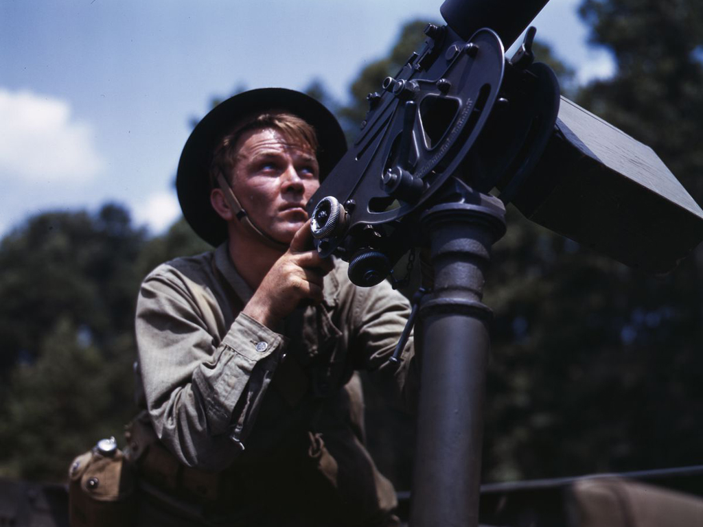 Life at Fort Knox in 1942 - 12. A Browning machine gun is aimed by an infantryman