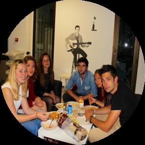 travelers eating food around table