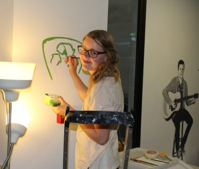 girl painting eco friendly logo acyh