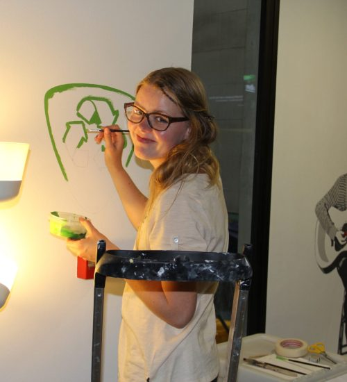 girl painting eco friendly logo acyh