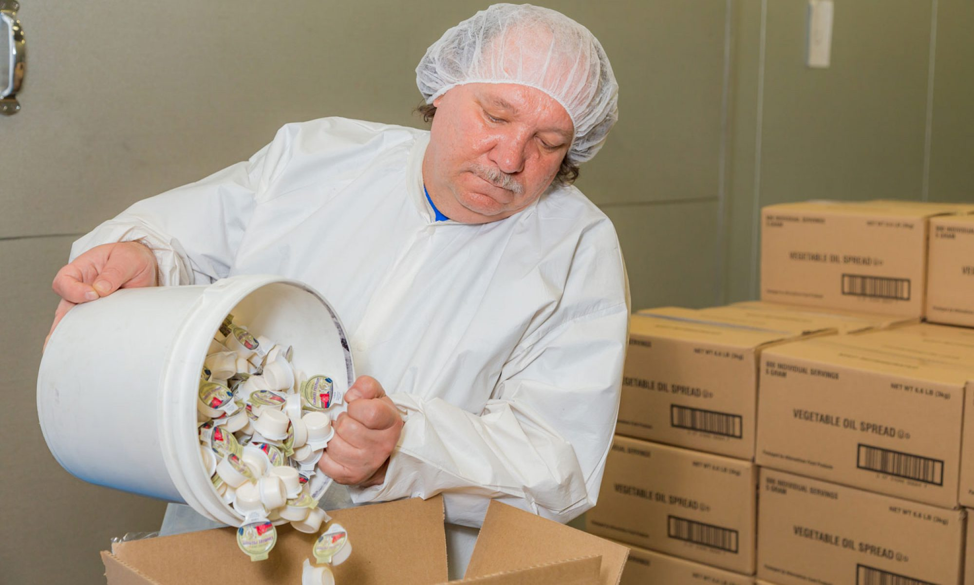 Alternatives Industry worker repackaging products. This is just one of the many services that can be provided to our clients.
